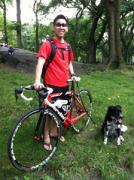 A bicyclist with a dog