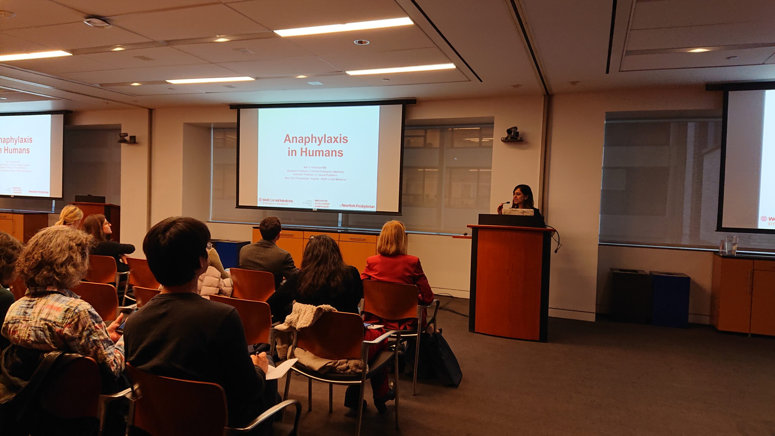 Dr. Friedman at the podium speaking on anaphylaxis in humans