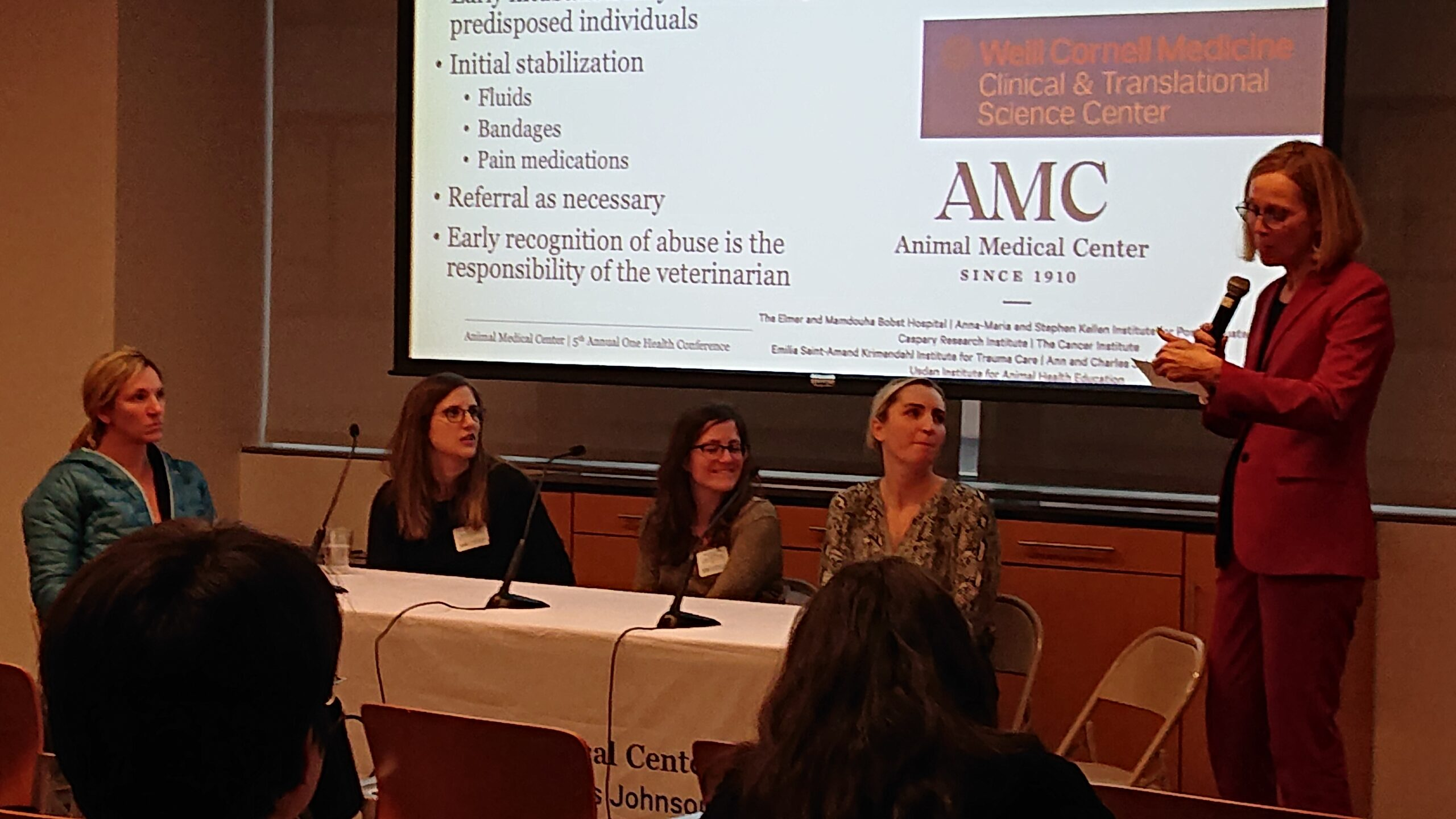 Dr. Bazzle, Dr. Keyserling, Dr. Cazzoli, and Dr. Zollo sitting at table for panel with Dr. Quesenberry as the moderator
