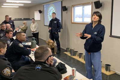 The Animal Medical Center's Dr. Heather Brausa conducts an educational seminar for NYPD K9 officers