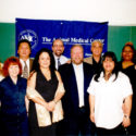 AMC employees pose for group photo at an appreciation event in 2002