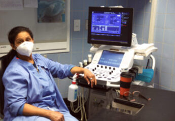 A veterinary professional sits at an echocardiogram machine at the Animal Medical Center
