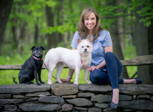 Victoria Schade posing with her two dogs