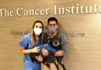 Dr. Laura Chadsey with her dog at AMC Cancer Institute